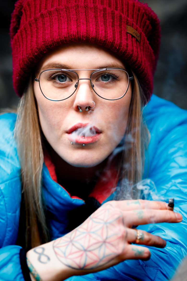 Cannabis Lifestyle Photography: Cute Girl Smoking Cannabis in Nature