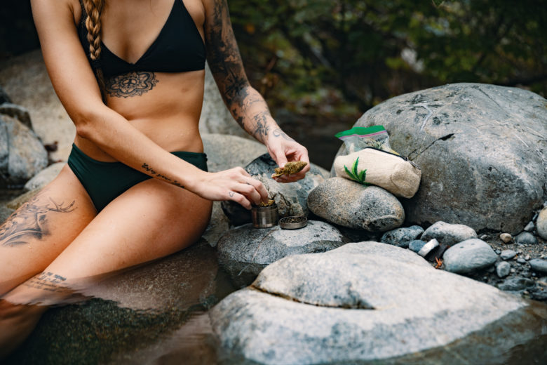 Cannabis Lifestyle Photography: Cute Girl Smoking Cannabis in Hot Springs